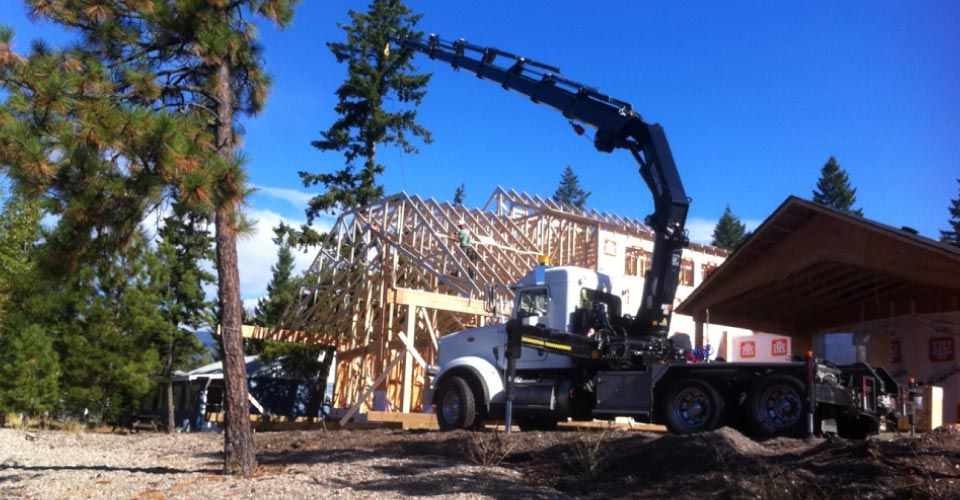 Crane Lifting Trusses on to Roof