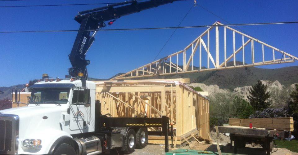 Crane Lifting Trusses on to Building